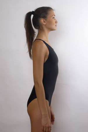 Side view of young woman in studio