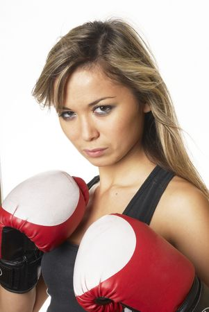 Boxing girl in boxing gloves in studio