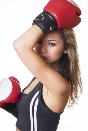 Boxing girl in boxing gloves in studio photo