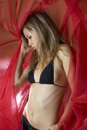 Girl in brassiere in studio on red background Stock Photo - 5853721