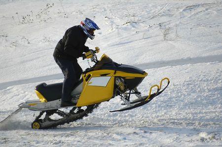 Training sportsman on motorized snowmobile photo