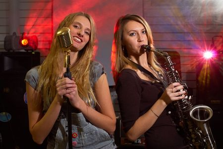 Woman with saxophone on music concert photo