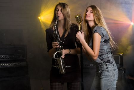Women with saxophone and microphone at music concert Stock Photo - 6191465