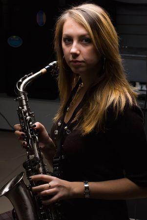 Woman with saxophone at music concert photo