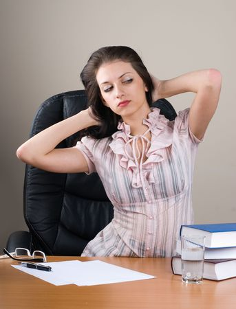 Young businesswoman working behind table photo