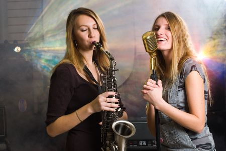 women with saxophone and microphone at concert photo