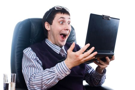 Young shocking businessman reading message on laptop photo