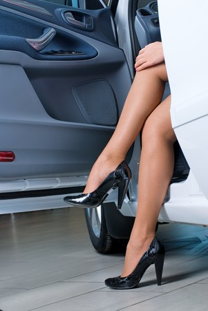 Woman leg of driver in car with open door Stock Photo - 7310078