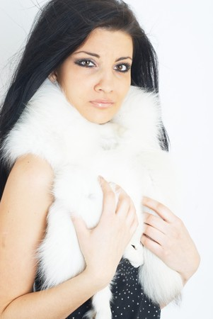 fur hood: Portrait of a beautiful girl wearing white fur Stock Photo