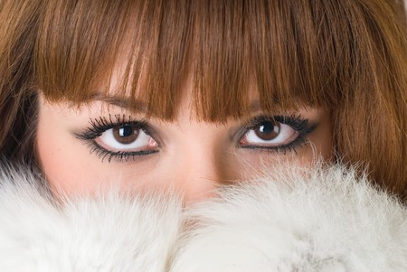 Portrait of a beautiful girl wearing white fur photo