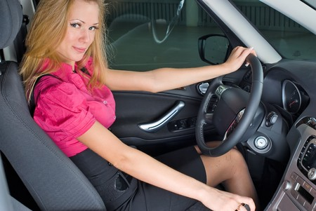 Young woman driving car. Inside view. photo