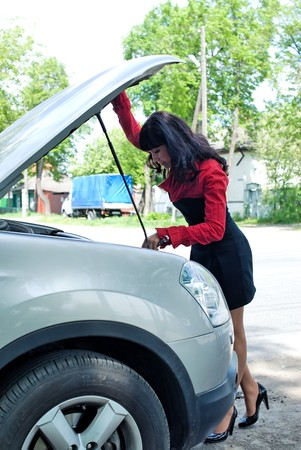 business woman with a car breakdown photo