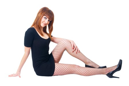 Beautiful red-haired girl on white background. Studio shot photo