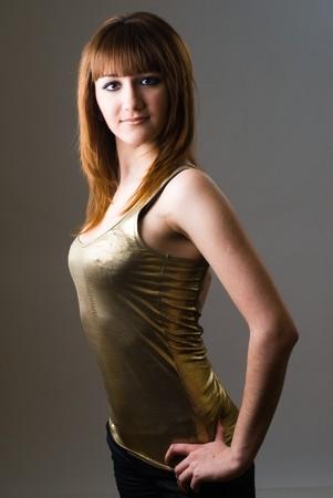 Beautiful redheaded girl posing in studio on white background photo