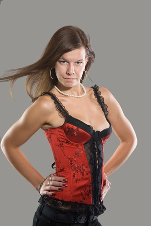 Girl in red erotic corset with open breast Stock Photo - 7839473