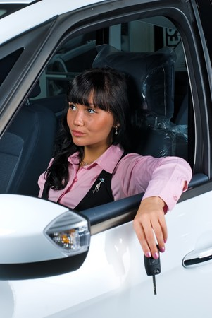 Woman Sitting In Car Getting Ready To Drive Stock Photo - 7839503