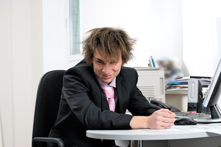 Young businessman on office workplace with computer photo