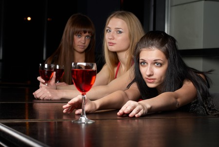 Group of women at cocktail party have fun photo