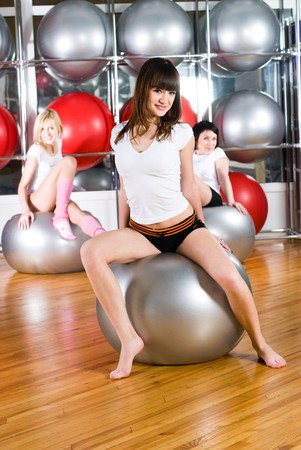 Young beautiful women training in fitness center photo