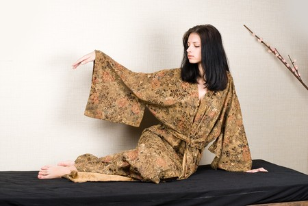 Young woman relaxing in japanese spa with sauna photo