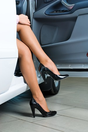 Young lady get out of the car Stock Photo - 8048574