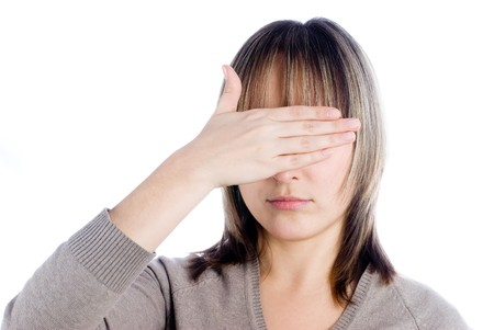 Woman closing eyes by palm at isolated background