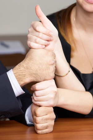 two male and two female hands with thumbs up photo