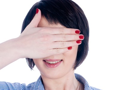 Woman closing eyes by palm at isolated background photo