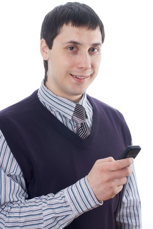 Smiling attractive businessman texting with a mobile phone photo