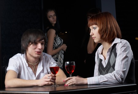 Young man and woman sitting in cafe Stock Photo - 8109700