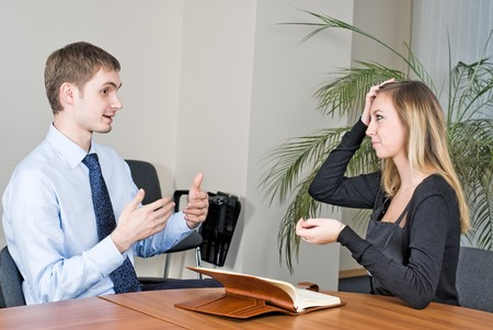 Two businesspeople at an interview in the office.