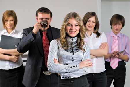Young business team with beautiful boss in office photo