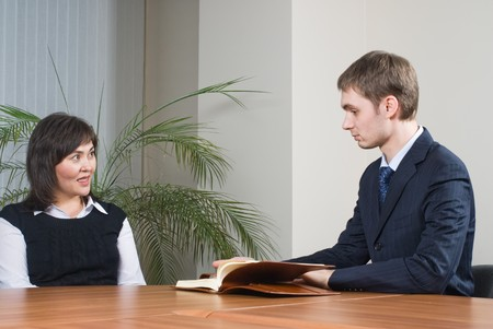 Business communication in office between businessman and businesswoman photo