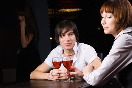 Young man with attractive woman with red-wine photo