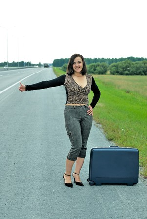 Woman with suitcase photo