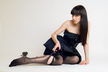 Young woman in torn stockings Stock Photo - 8304073