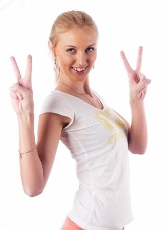 Woman with victory sign photo