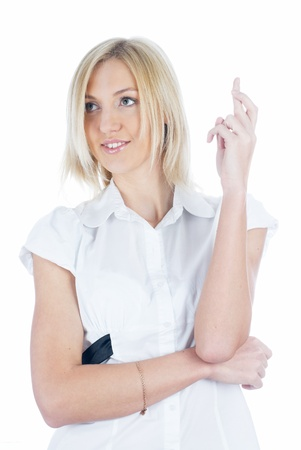 crossed fingers: Girl with crossed fingers Stock Photo