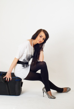 Beautiful girl with suitcase photo