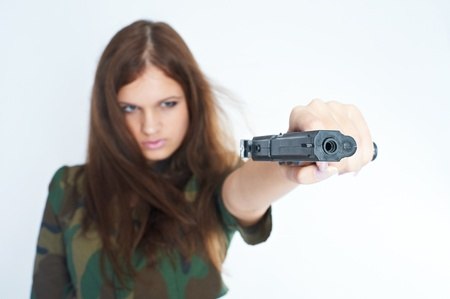 Pretty woman with a gun Stock Photo - 8676356