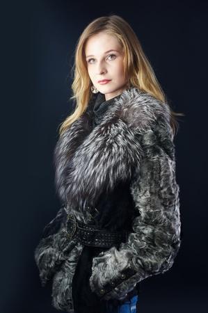 Attractive woman in fur coat photo