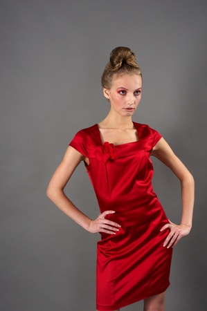 Sexy slim woman in red dress photo