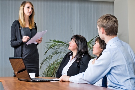 Woman making a business presentation  photo