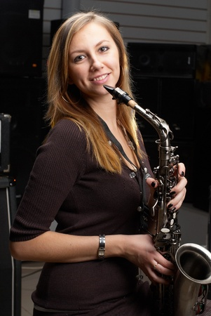 Woman with saxophone photo