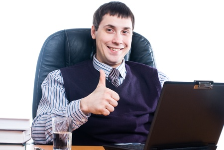 Portrait of a young businessman with laptop photo