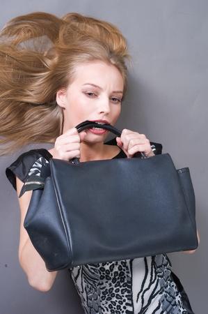 Sexy fashionable woman with bag photo