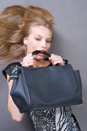 Sexy fashionable woman with bag photo