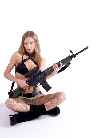 Woman with gun on white Stock Photo - 9119439