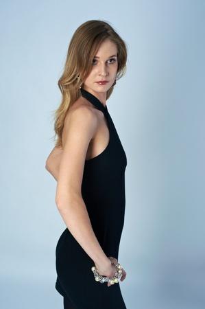 Beautiful woman in black dress photo