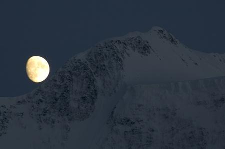 Moon over Belukha summit Stock Photo - 9376988